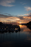 Yachts in harbor with sunset Stock Image