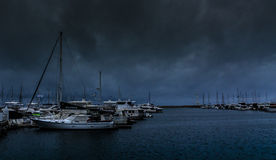Yachts harbor under cloudy day Stock Photos