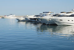 Yachts in a harbour Stock Photos