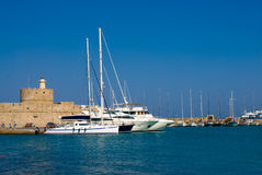 Yachts in a harbour. A boat in a harbour Rhodes. Rhodes island. Greece Royalty Free Stock Photos