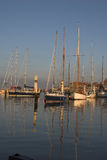 Yachts in harbour. Yachts berthed in harbour with reflections Stock Photos