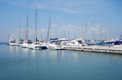 Yachts in harbour. Yachts belayed in harbour in sunny weather stock photos