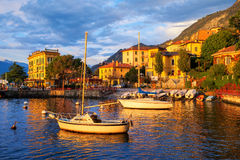 Yachts in a harbour on Lake Como, Italy, on sunset stock images