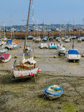 Yachts in a harbour during outflow Stock Photos