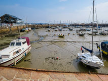 Yachts in a harbour during outflow Royalty Free Stock Photography