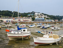 Yachts in a harbour during outflow Stock Image