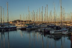 Howth Harbour, Co Dublin, Ireland, 29th February 2018. Yachts in Howth Harbour, Sunset in Howth, yachts reflection in the Irish Sea Royalty Free Stock Photos