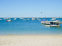 Yachts and jetty. On a sunny day Stock Image