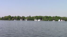 Yachts on the lake. Yachts on the Herastrau lake, Bucharest stock video footage