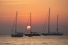 Yachts in the Ligurian sea at sunrise Stock Photo
