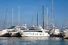 Yachts located in a marina in Mallorca Spain. Luxury yachts located in a marina in Mallorca, Spain Royalty Free Stock Image