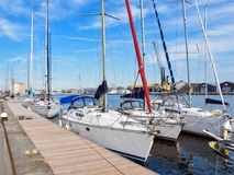Yachts with lowered sails near the pier. Yachts with lowered sails near the pier in the French city of Saint-Malo stock photo