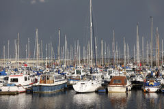 Yachts in a marina. Yachts and boats in a marina, dark sky stock photos
