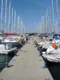 Yachts in marina. Sailing yachts anchored in marina Stock Photo