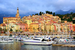 Yachts in the marina of colorful medieval town Menton on french Stock Photos