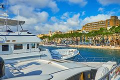 The cityscape with yachts, Valletta, Malta. The yachts in marina of Valletta are perfect place to observe small towns on seashores, such as Ta`Xbiex with green Stock Images
