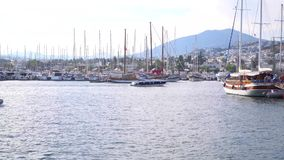 Yachts in marina with white houses on the background Bodrum, Turkey stock footage