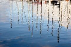 Yachts masts reflection Royalty Free Stock Photos