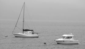 Yachts on a misty scottish loch Royalty Free Stock Photography