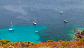 Yachts moored in azure bay, South Corsica Stock Photo