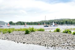 Yachts moored on the banks of Coniston water. Yachts moored close to the banks of Coniston water, close to Coniston village in the English Lake District Royalty Free Stock Photo
