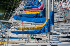 Yachts Moored at Bell Park. OTTAWA, CANADA - JULY 21: Yachts moored at the Nepean Sailing Club on July 21, 2013 at Bell Park on the Ottawa River in Ottawa stock photography