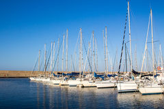 Yachts moored in a harbor Stock Photos