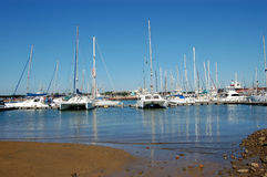 Yachts moored in harbour. Image of yachts and other boats moored in a harbor Stock Photo