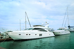 Yachts moored in harbour Stock Images