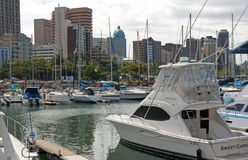 Yachts Moored In Harbour Against Durban City Skyline Royalty Free Stock Photos