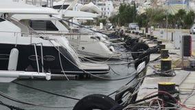 Yachts moored at Manoel Island Marina in Malta. Sail boats in a row on docks at seaside harbor stock video footage