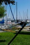 Yachts moored at marina. At beautiful sunny day and hammock Royalty Free Stock Images