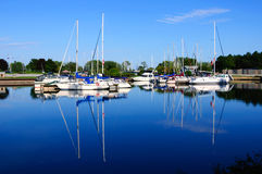 Yachts moored at Marina on a summer day. Stock Photos