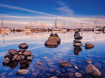 Yachts moored at the marina  at the sunset Royalty Free Stock Photos