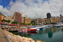 Yachts Moored In Monaco Harbour. A colourful scene showing a few smaller yachts moored at a marina in the Monaco port stock images