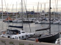 Yachts moored near the embankment of the Valencia city of Spain in a clear sunny windy day. Europe. Mediterranean sea. Touristic p. Lace. Winter 2015 Royalty Free Stock Photography