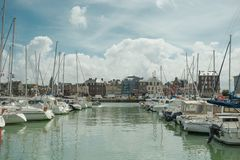 Yachts moored at quay port of Dieppe, France. Concepts of success, leisure, holiday, rich, tourism, luxury, lifestyle Royalty Free Stock Image