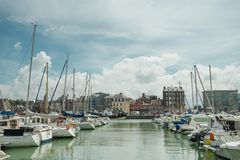 Yachts moored at quay port of Dieppe, France. Concepts of success, leisure, holiday, rich, tourism, luxury, lifestyle Royalty Free Stock Photos
