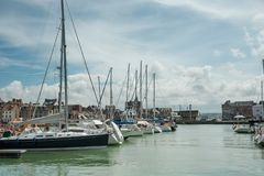 Yachts moored at quay port of Dieppe, France. Concepts of success, leisure, holiday, rich, tourism, luxury, lifestyle Stock Image