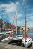 Yachts moored at quay port of Honfleur, France. Concepts of success, leisure, holiday, rich, tourism, luxury, lifestyle Stock Photos