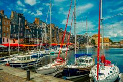 Yachts moored at quay port of Honfleur, France. Concepts of success, leisure, holiday, rich, tourism, luxury, lifestyle Stock Images