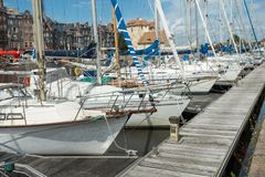 Yachts moored at quay port of Honfleur, France. Concepts of success, leisure, holiday, rich, tourism, luxury, lifestyle Stock Photo