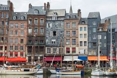 Yachts moored at quay port of Honfleur, France. Concepts of success, leisure, holiday, rich, tourism, luxury, lifestyle Royalty Free Stock Photography