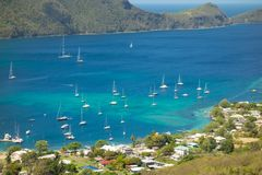 Yachts moored at a sheltered harbor in the windward islands Stock Image