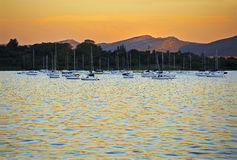 Yachts moored at sunset Royalty Free Stock Photo