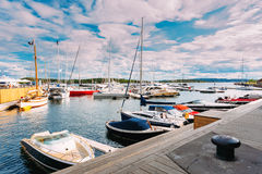 Yachts moored at town quay in district Aker Brygge, Oslo, Norway Stock Photos