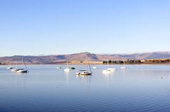 Yachts Moored in a Tranquil Setting on the Midmar Dam Royalty Free Stock Photos
