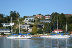 Yachts mooring in the Bay of Islands New Zealand. OPUA - MAY 11 2014:Yachts mooring at Opua marina.It's New Zealands northernmost port of entry for overseas Royalty Free Stock Photo