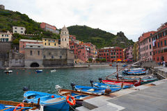 Yachts at the mooring on the embankment. Vernazza — one of five settlements of national park of Cinque Terre Stock Image