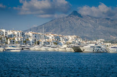 Yachts mooring Puerto Banus, Marbella. Luxury yachts mooring in Puerto Banus. January 2015 with La Concha in the background. Blue sky Royalty Free Stock Image